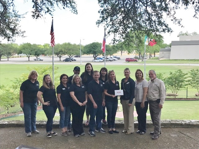 First Commercial Bank presenting donation to the Seguin Chamber Leadership Class for improvements to the Juan Seguin Burial Site.